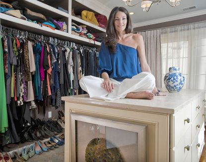 Amanda Austin in her closet, which has plenty of natural lighting thanks to several windows.
