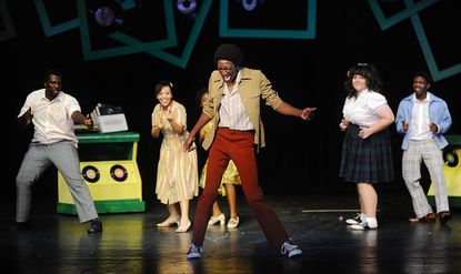 """Playing Seaweed J. Stubbs, Najee Banks dances in a dress rehearsal of McDaniel College's production of """"Hairspray"""" at WMC Alumni Hall in Westminster Monday night, October 1, 2012."""