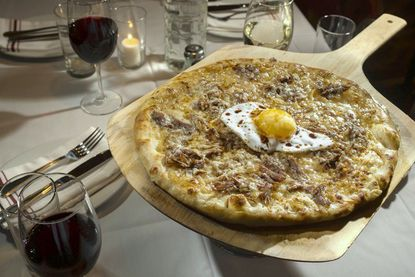 Birroteca features a large selection of craft beer, wines and artisan pizzas on its menu. A favorite is the Duck, Duck, Goose pizza featuring duck confit, fig onion jam, and duck egg.
