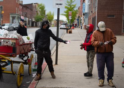 As the coronavirus spread in April and May, Baltimore arabbers were given face masks to distribute on their produce-vending routes in the city.