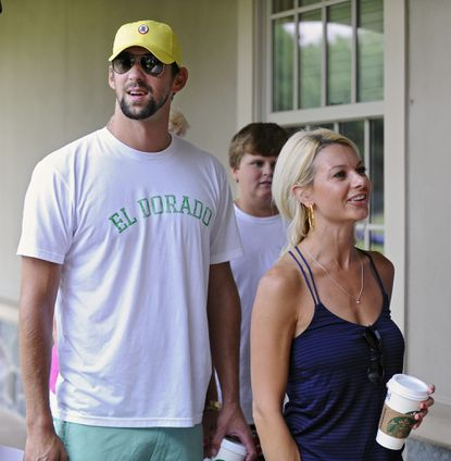 Michael Phelps and girlfriend Win McMurry visit during Ravens training camp.