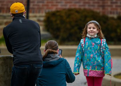 Six-year-old Victoria LaBuff poses for her parents Jesse and Zuzana on her first day of kindergarten at Stoneleigh Elementary School.