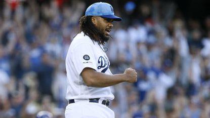 Dodgers closer Kenley Jansen reacts after watching center fielder Alex Verdugo make a diving catch to end the game against the Cubs.