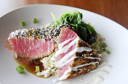 Tuna Two-Ways at Bluestone features sushi grade tuna with a light coating of sesame seeds and cajun seasoning, pan seared rare, brushed with a cucumber-wasabi sauce and ginger glaze.