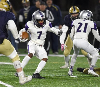 Joppatowne's Shakur Johnson makes a move as he sees a hole in the line during Friday night's Class 1A East playoff game at Perryville.