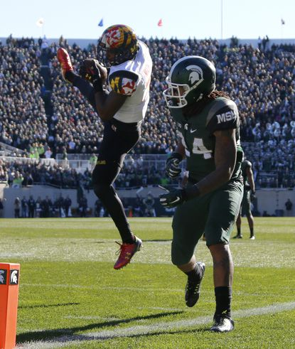 Maryland's Anthony Nixon, left, intercepts a pass intended for Michigan State's Gerald Holmes during the second quarter, Saturday, Nov. 14, 2015, in East Lansing, Mich.