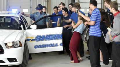 Deputy Tim Chrismer with the Carroll County Sheriffs Office demonstrates a police cruiser for students attending the Drug and Violence Expo at the Carroll County at the Agricultural Center in Westminster in 2015. The event returns for its fifth year on Thursday at the Ag Center.