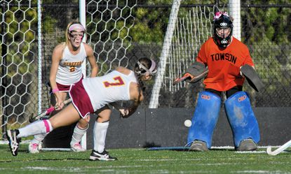 Hereford's Emma Vicchio fires on a shot at Towson goalie Jamesy Wood during the Bulls' 1-0 victory on Oct. 8.