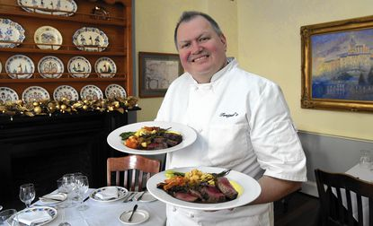 Michel Tersiguel, chef/owner of Tersiguel's in Ellicott City, holds his chateaubriand for two, a dish that is not on the menu but that customers can order if they call ahead.