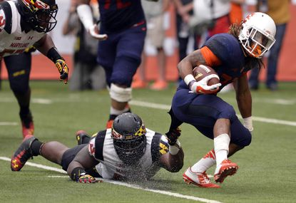 Maryland Terrapins defensive lineman Darius Kilgo (97) tackles Syracuse Orange running back Prince-Tyson Gulley (23) by his jersey during the second half at the Carrier Dome. Maryland won the game 34-20.