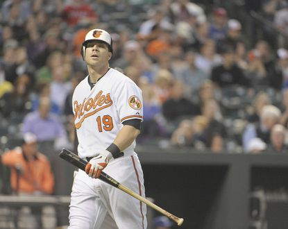 Orioles first baseman Chris Davis walks back to the dugout after his third-inning strikeout.