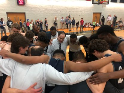 Gilman head coach Will Bartz gets his team hyped up prior to a 66-64 win over Boys' Latin.