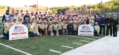 Members of the Navy men's and women's outdoor track and field teams pose with the trophies after sweeping the Patriot League Championship meet at Army West Point on May 1.