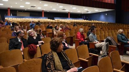 Members of the public listen at a forum for feedback on Baltimore County's superintendent search at Loch Raven High School on March 22.