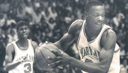 Maryland forward Len Bias drives to the basket as teammate Keith Gatlin looks on.