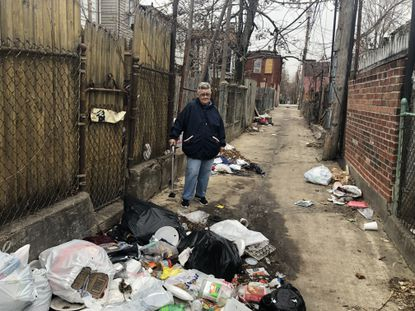 Judy Taylor said she calls 311 often to report the dirty alley behind her rowhome in Southwest Baltimore's Carrollton Ridge neighborhood, shown here in a December 2019 photo.