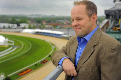 Larry Collmus poses at Pimlico Race Course before the 2011 Preakness.