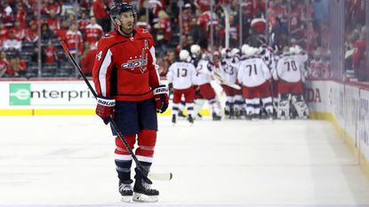 The Columbus Blue Jackets celebrate the winning goal in overtime as Brooks Orpik of the Washington Capitals skates off the ice. Columbus won, 5-4, in Game 2 of the Eastern Conference first-round series at Capital One Arena in Washington.