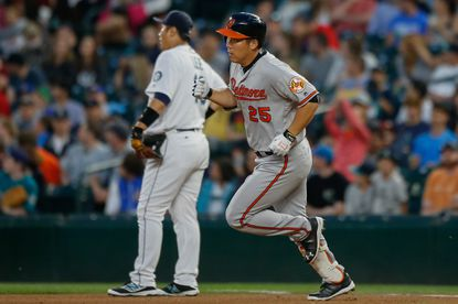 Hyun Soo Kim rounds the bases, past Mariners first baseman Dae-Ho Lee, after hitting a solo home run in the seventh inning Thursday night.