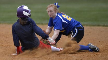 Liberty's Abby Devine tags out FSK's Rachael Wright at second base in the second inning of the Lions' win over FSK in Uniontown Monday, April 9, 2018.
