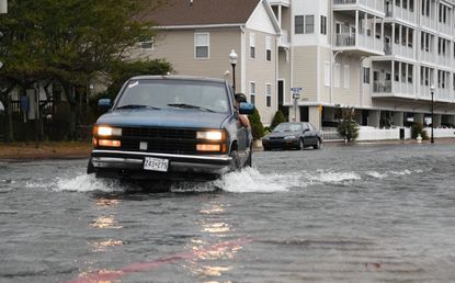 Flooding along Dorchester Street near the inlet in Ocean City, Maryland in September of 2019. Rising tides caused by man-made climate change are expected to make such events more frequent in the years to come. (Lloyd Fox/Baltimore Sun).