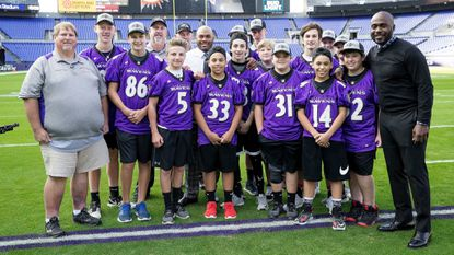 "The Hampstead Ravens 13U football team took the field at M&T Bank Stadium on Oct. 26 prior to the ""Thursday Night Football"" game between the Baltimore Ravens and the Miami Dolphins."