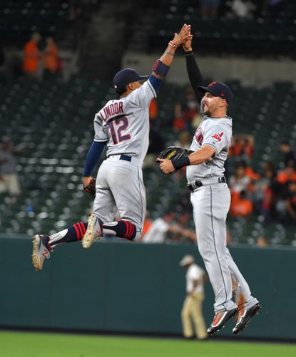 Indians' teammates Francisco Lindor and Lonnie Chisenhall celebrate their 5-1 victory in June over the Orioles. The teams meet in Cleveland this weekend for a three-game series.