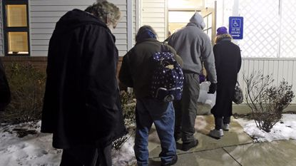Clients line up outside the cold weather shelter in Westminster while waiting to be let in Saturday, Jan. 10.