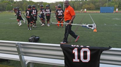 The City College boys lacrosse team remembers teammate Ray Glasgow III by placing his jersey on the team bench during the Division A championship game in May.