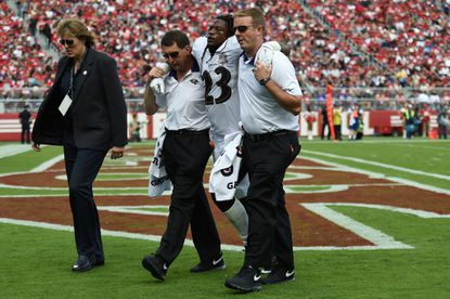 Safety Kendrick Lewis leaves the field Sunday after a leg injury.