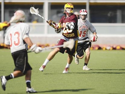 Hereford's Joe Seider, center, winds up for shot in last year's Class 3A-2A state championship victory over Glenelg. Seider scored twice in Tuesday night's 7-6 upset of Gilman.