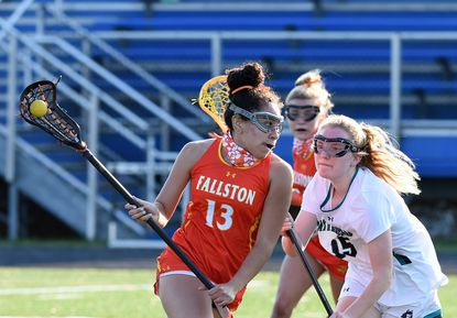 Fallston's Julianna Williams drives to the goal with Patterson Mill's Caitlyn Welker closing in on defense during Thursday evening's game at Patterson Mill April, 8, 2021.