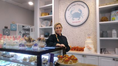 Carrie Olish owner of Blue Crab Cupcakes, with some of her creations.