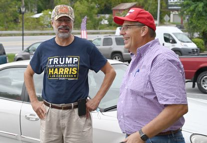 Congressman Andy Harris, left, talks with David Brauning Jr., chair of the Carroll County Republican Central Committee, during the opening of their headquarters located in Finksburg, on Saturday, Sept. 12.