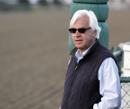 Trainer Bob Baffert watches his Preakness entrant Bayern gallop at Pimlico Race Course in Baltimore last year.
