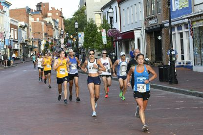 Participants reach the foot of Main Street during the Annapolis 10-Mile Run on Sunday morning.
