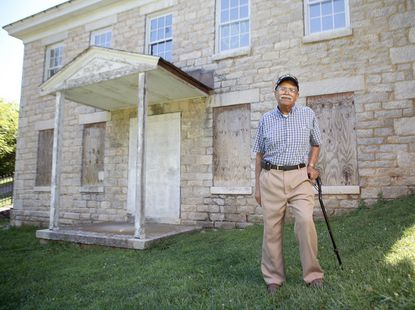 Louis Diggs outside a historic building in Cockeysville that residents want to turn into a research center for county African American history.