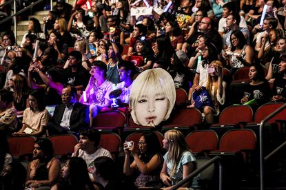 FILE -- A cut-out in the crowd at KCON, a Korean pop music festival, at the Prudential Center in Newark, N.J., Aug. 8, 2015. After claiming some credit for the fizzling of President Trump's rally in Oklahoma, the online armies of Korean pop music listeners are feeling prepared and empowered.