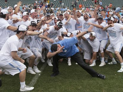 Head coach Joe Breschi of the North Carolina Tar Heels does the dab with his team after the game against the Maryland Terrapins in the NCAA Division I Men's Lacrosse Championship at Lincoln Financial Field on May 30, 2016 in Philadelphia.