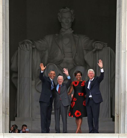 "President Barack Obama (L) stands with his wife Michelle Obama (2nd-R) former presidents Jimmy Carter (2nd-L) and Bill Clinton during the ceremony to commemorate the 50th anniversary of the March on Washington for Jobs and Freedom August 28, 2013 in Washington, DC. It was 50 years ago today that Martin Luther King, Jr. delivered his ""I Have A Dream Speech"" on the steps of the Lincoln Memorial."