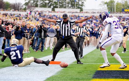 Navy slotback Gee Gee Greene, left, can't come up with a touchdown catch against East Carolina.