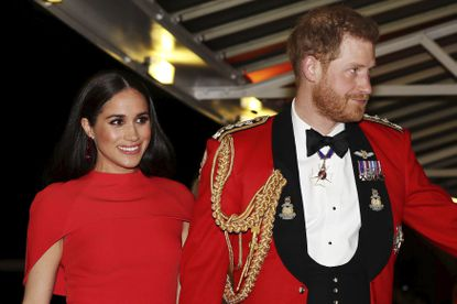 In this Saturday March 7, 2020 file photo, Britain's Prince Harry and Meghan, Duchess of Sussex arrive at the Royal Albert Hall in London, to attend the Mountbatten Festival of Music. Harry and Meghan stepped away from full-time royal life in early 2020, and Buckingham Palace on Friday Feb. 19, 2021, confirmed the couple will not be returning to royal duties, and Harry will give up his honorary military titles. (Simon Dawson/Pool via AP, file)