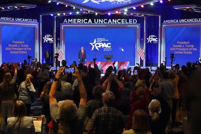 Supporters cheer and wave as former President Donald Trump is introduced at the Conservative Political Action Conference on Sunday, Feb. 28, 2021, in Orlando, Florida. (AP Photo/John Raoux)