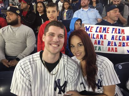 Andrew Fox and Heather Terwilliger sit in the stands at Yankee Stadium on Sept. 27, 2016. When Fox pulled the ring from his pocket and dropped to one knee before Terwilliger to propose during the fifth inning of the Yankees' game, the ring dropped to the ground. A frantic search ensued. After about five minutes, Terwilliger looked down and saw something shiny in the cuff of her pants leg.