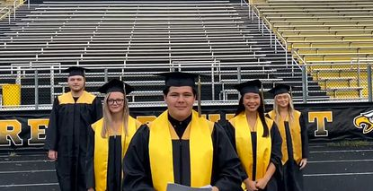 """Frame grab from Northeast 2020 """"Virtual Graduation Ceremony"""" Senior representatives turn theirrings and tassels after graduation."""