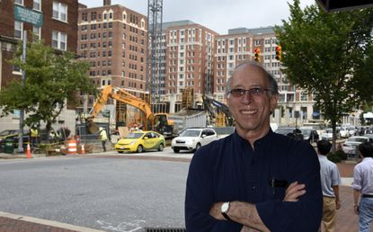 Jerry Gordon, owner of Eddie's of Charles Village, stands in front of construction related to Johns Hopkins University at 33rd and St. Paul streets.