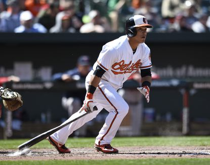 Baltimore Orioles' Everth Cabera follows through on a swing against the Boston Red Sox, Sunday, April 26, 2015, in Baltimore.