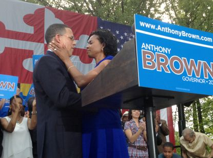 Maryland Lt. Governor Anthony Brown is hugged by his wife Karmen Walker Brown after he announced his candidacy for governor in Largo Friday.