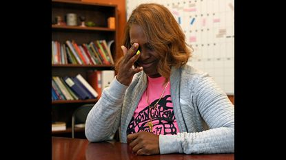 Kiara Hargrove, principal of Monarch Academy Baltimore, wipes away tears as she talks about the closing of the public charter school. The Baltimore school board voted in January to close Monarch and four other schools.