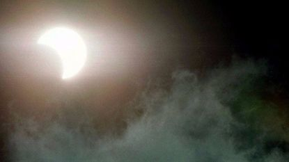 The Moon begins to move in front of the sun during a solar eclipse Feb. 26, 1998, as viewed from Fort Lauderdale, Fla.